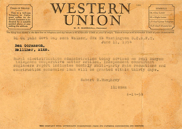 A telegram from Senator Hubert H. Humphrey stating an REA loan approval for Paul Bunyan Telephone.