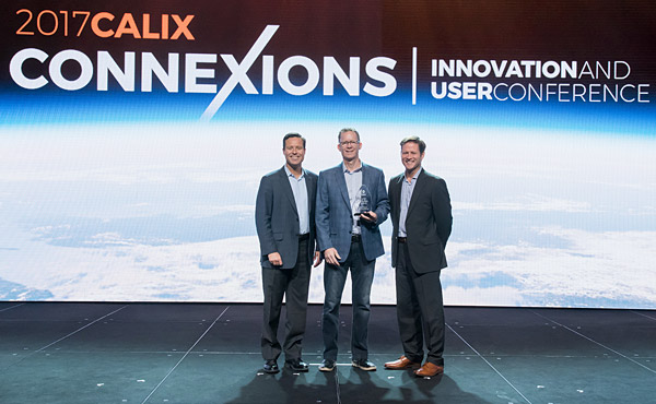 Paul Bunyan Communications CEO, Gary Johnson (center) is presented with the Calix Best Innovation in Residential Subscriber Experience for 2017